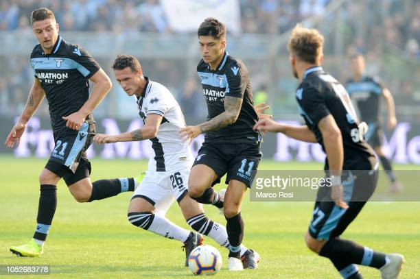 Joaquin Correa of SS Lazio compete for the ball with Luca Siligardi of Parma Calcio during the Serie A match between Parma Calcio and SS Lazio at...