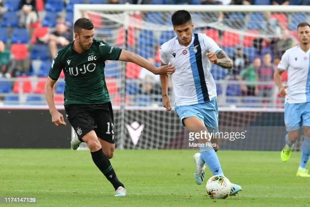 Joaquin Correa of SS Lazio compete for the ball with Mattia Bani of Bologna FC during the Serie A match between Bologna FC and SS Lazio at Stadio...
