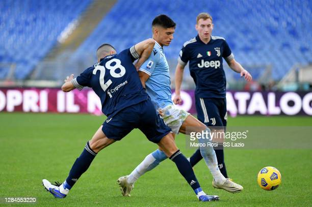 Joaquin Correa of SS Lazio compete for the ball with Merih Demiral during the Serie A match between SS Lazio and Juventus at Stadio Olimpico on...