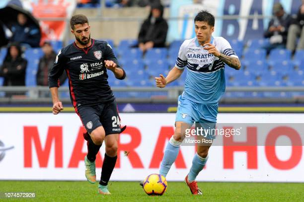 Joaquin Correa of SS Lazio compete for the ball with Paolo Farag˜ of Cagliari during the Serie A match between SS Lazio and Cagliari at Stadio...