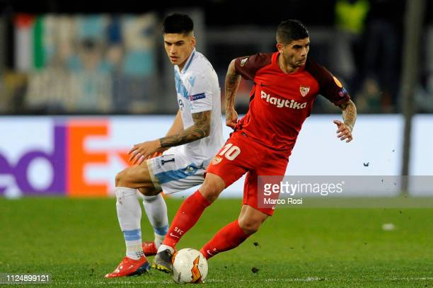 Joaquin Correa of SS Lazio competes for the ball with Ever Banega of Sevilla during the UEFA Europa League Round of 32 First Leg match between SS...