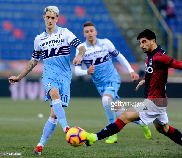 Joaquin Correa of SS Lazio competes for the ball with Riccardo Orsolini of Bologna FC during the Serie A match between Bologna FC and SS Lazio at...