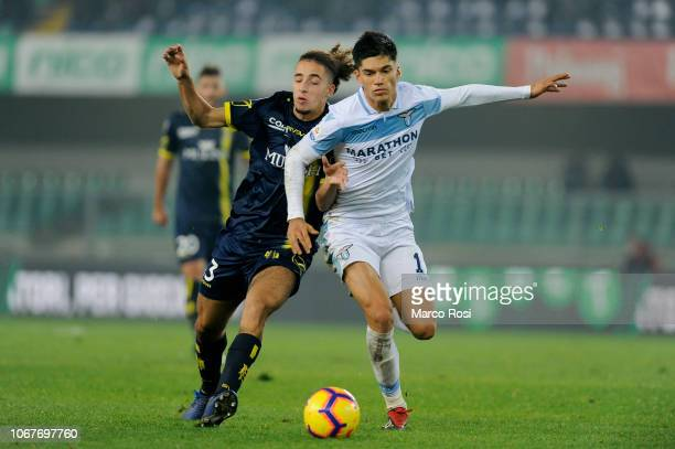 Joaquin Correa of SS Lazio competes for the ball with Sofian Kiyine of Chievo Verona during the Serie A match between Chievo Verona and SS Lazio at...