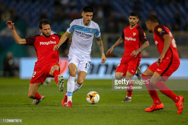 Joaquin Correa of SS Lazio is challenged by Franco Vazquez of Sevilla during the UEFA Europa League Round of 32 First Leg match between SS Lazio and...