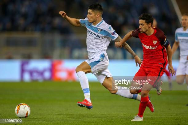 Joaquin Correa of SS Lazio is challenged by Jesus Navas of Sevilla during the UEFA Europa League Round of 32 First Leg match between SS Lazio and...