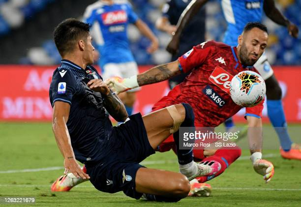 Joaquin Correa of SS Lazio is challenged fot the ball against David Ospina of SSC Napoli of SS Lazio during the Serie A match between SSC Napoli and...