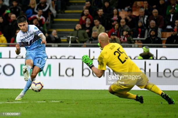 Joaquin Correa of SS Lazio kicks the ball against Jos Reina of AC Milan during the TIM Cup match between AC Milan and SS Lazio at Stadio Giuseppe...