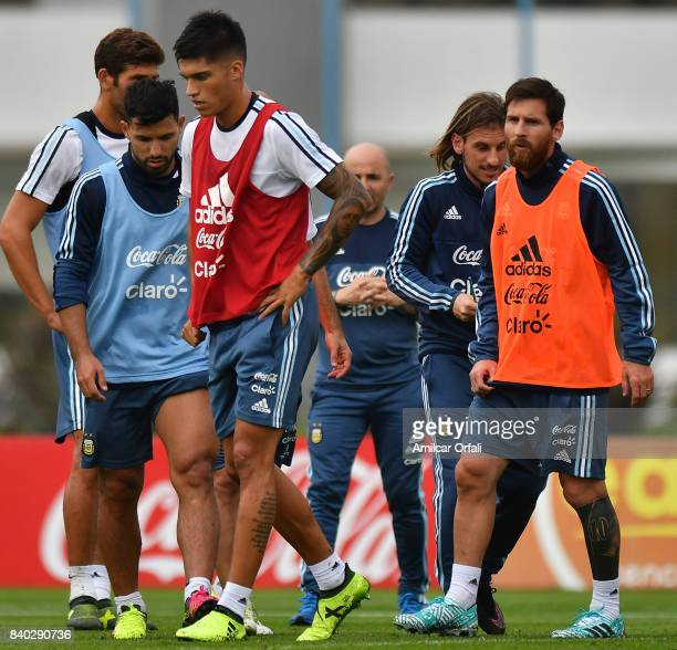 Joaquin Correa Sergio Aguero and Lionel Messi of Argentina look on during a training session at 'Julio Humberto Grondona' training camp on August 28...