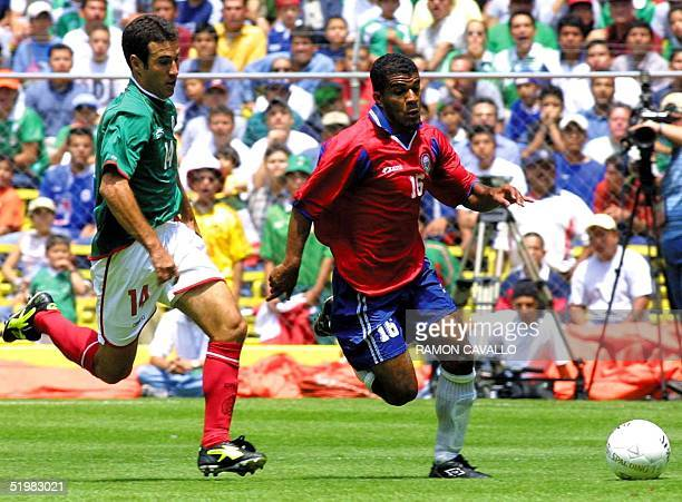 Joaquin del Olmo of the Mexican soccer team fights for the ball with Steven Bryce of Costa Rica in a qualifying match for the World Cup 2002 to be...