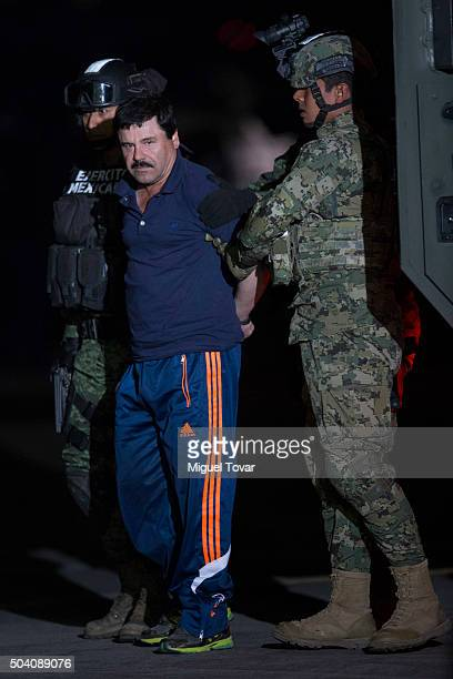 Joaquin 'El Chapo' Guzman is escorted after President of Mexico Enrique Pe–na Nieto announced his detention on January 08 2016 in Mexico City Mexico...