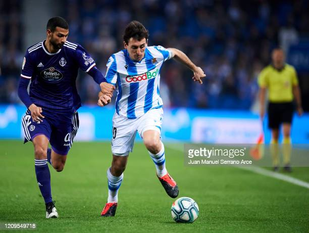 Joaquin Fernandez of Real Valladolid CF duels for the ball with Mikel Oyarzabal of Real Sociedad during the Liga match between Real Sociedad and Real...