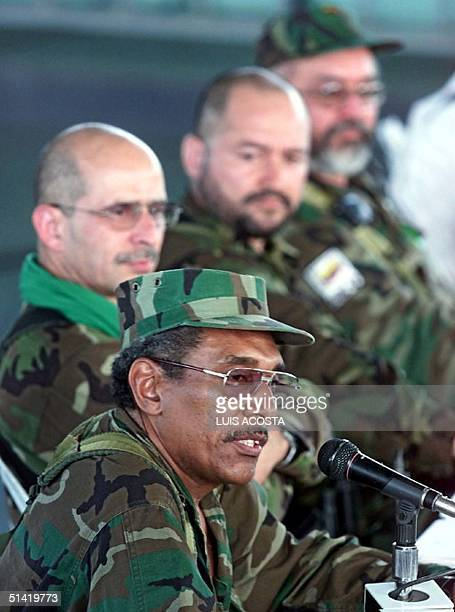 Joaquin Gomez leader of the Fuerzas Armadas Revolucionarias of Colombia speaks during a meeting in Los Pozos 14 February 2002 Joaquin Gomez vocero de...