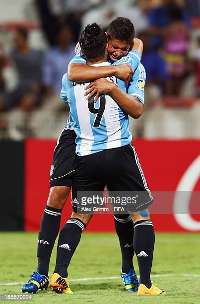 Joaquin Ibanez celebrates his team's first goal with team mate Sebastian Driussi during the FIFA U-17 World Cup UAE 2013 Group E match between...