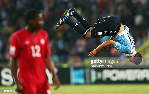 Joaquin Ibanez of Argentina celebrates his team's first goal as Kevon Black of Canada reacts during the FIFA U17 World Cup UAE 2013 Group E match...