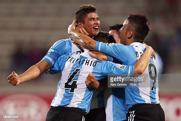 Joaquin Ibanez of Argentina celebrates his team's first goal with team mates Nicolas Tripichio and Sebastian Driussi during the FIFA U-17 World Cup...
