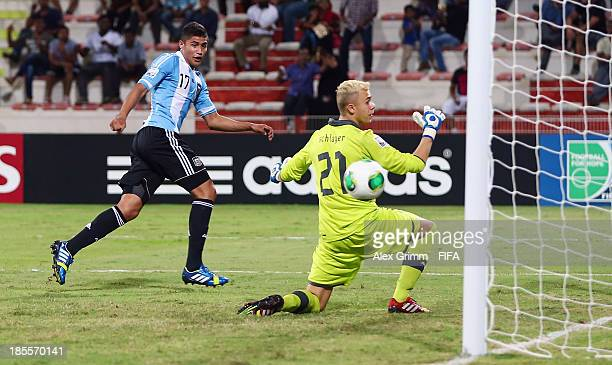 Joaquin Ibanez of Argentina scores his team's first goal against goalkeeper Alexander Schlager of Austria during the FIFA U-17 World Cup UAE 2013...