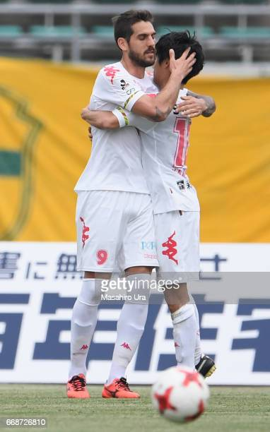 Joaquin Larrivey of JEF United Chiba celebrates scoring the opening goal with his team mate Yamato Machida during the J.League J2 match between...