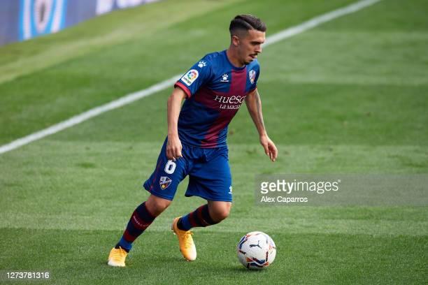 Joaquin Munoz of SD Huesca conducts the ball during the La Liga Santander match between SD Huesca and Cadiz CF at Estadio El Alcoraz on September 20...