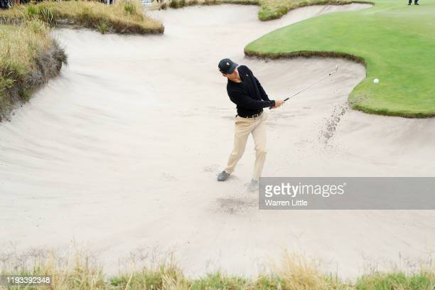 Joaquin Niemann of Chile and the International team plays a shot from a bunker on the second hole during Thursday four-ball matches on day one of the...