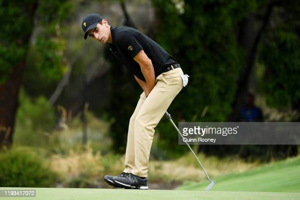 Joaquin Niemann of Chile and the International team reacts to a missed putt on the 14th green during Thursday fourball matches on day one of the 2019...