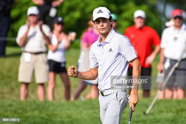 Joaquin Niemann of Chile celebrates and pumps his fist after making a birdie putt on the 18th hole green during the third round of the Memorial...