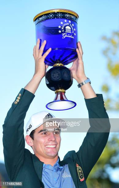 Joaquin Niemann of Chile celebrates with the trophy after winning A Military Tribute At The Greenbrier held at the Old White TPC course on September...
