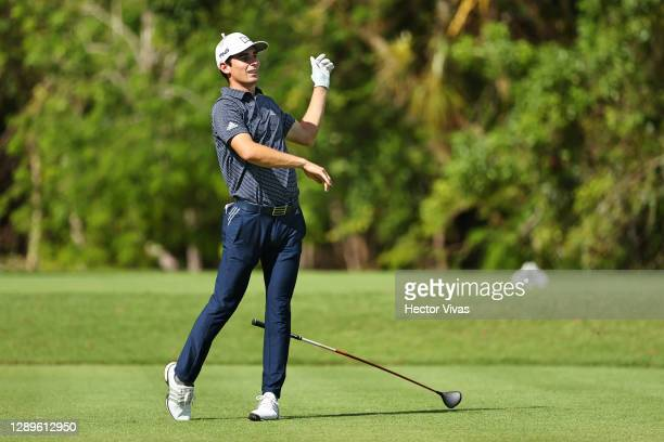 Joaquin Niemann of Chile drops his club as he plays his shot from the second tee during the third round of the Mayakoba Golf Classic at El Camaleón...