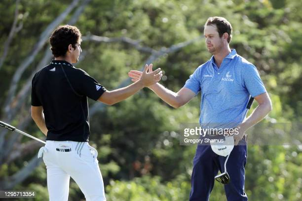 Joaquin Niemann of Chile greets Harris English of the United States after finishing on the 18th green in a playoff during the final round of the...