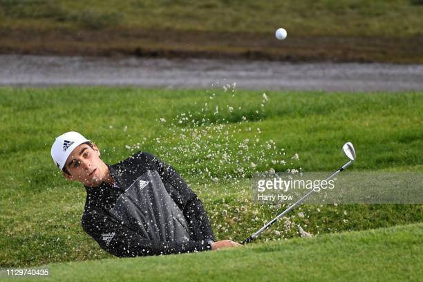 Joaquin Niemann of Chile hits out of the bunker on the second hole during the first round of the Genesis Open at Riviera Country Club on February 14...