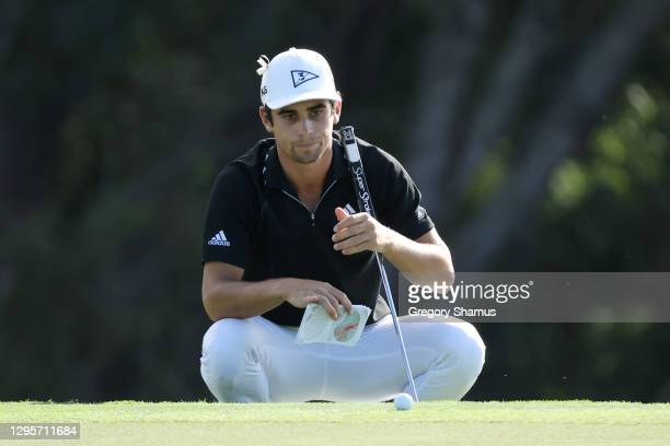 Joaquin Niemann of Chile lines up a putt on the 18th green in a playoff during the final round of the Sentry Tournament Of Champions at the Kapalua...