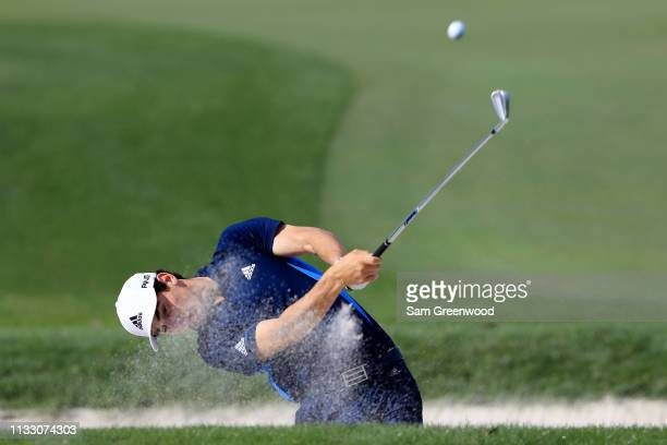 Joaquin Niemann of Chile plays a shot from a bunker on the sixth hole during the second round of the Honda Classic at PGA National Resort and Spa on...