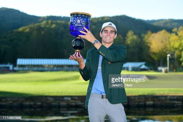 Joaquin Niemann of Chile poses with the trophy after winning A Military Tribute At The Greenbrier held at the Old White TPC course on September 15...
