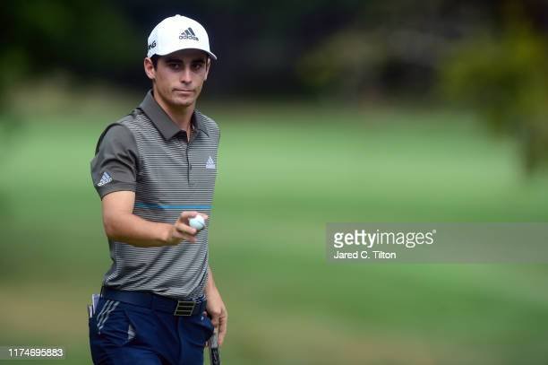 Joaquin Niemann of Chile reacts following his putt on the seventh green during the third round of A Military Tribute At The Greenbrier held at the...