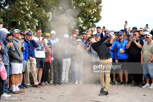 Joaquin Niemann of the International Team plays his second shot on the 10th hole in his match with Marc Leishman against Tiger Woods and Justin...