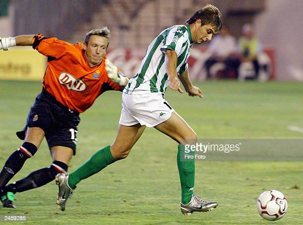 Joaquin of Betis evades Lemmens of Espanyol during the Primera Liga match between Real Betis and Espanyol at the Ruiz de Lopera Stadium on September...