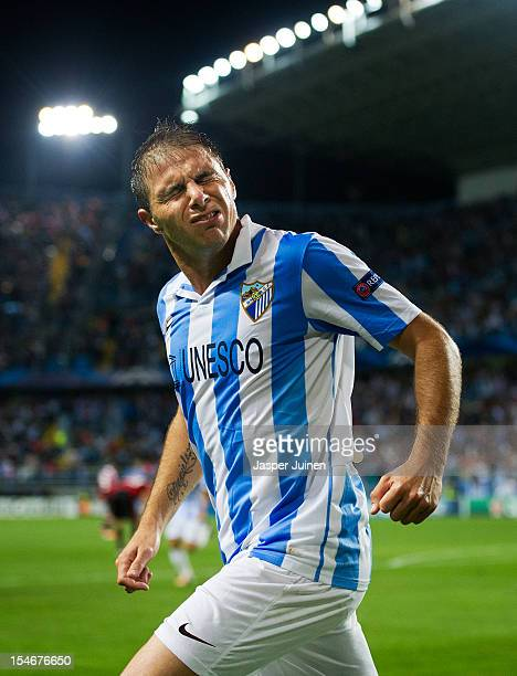 Joaquin of Malaga CF celebrates scoring his sides opening goal against AC Milan during the UEFA Champions League group C match between Malaga CF and...