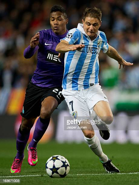 Joaquin of Malaga CF duels for the ball with Alex Sandro of FC Porto during the UEFA Champions League Round of 16 second leg match between Malaga CF...