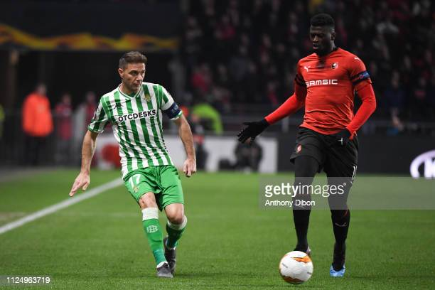 Joaquin of Real Betis and Mbaye Niang of Rennes during the UEFA Europa League Round of 32 First Leg match between Rennes and Real Betis at Roazhon...