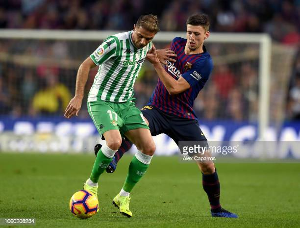 Joaquin of Real Betis battles for possession with Clement Lenglet of Barcelona during the La Liga match between FC Barcelona and Real Betis Balompie...