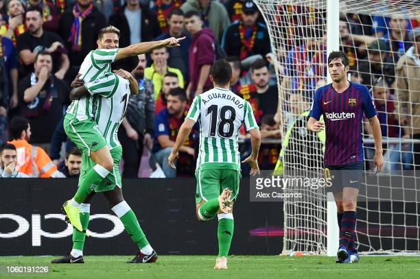 Joaquin of Real Betis celebrates with teammate William Carvalho of Real Betis after scoring his team's second goal during the La Liga match between...
