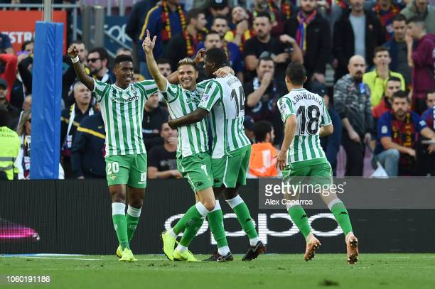 Joaquin of Real Betis celebrates with teammates after scoring his team's second goal during the La Liga match between FC Barcelona and Real Betis...