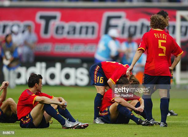 Joaquin of Spain is consoled by his teammates as he misses the penalty that loses the penalty shootout during the FIFA World Cup Finals 2002 Quarter...
