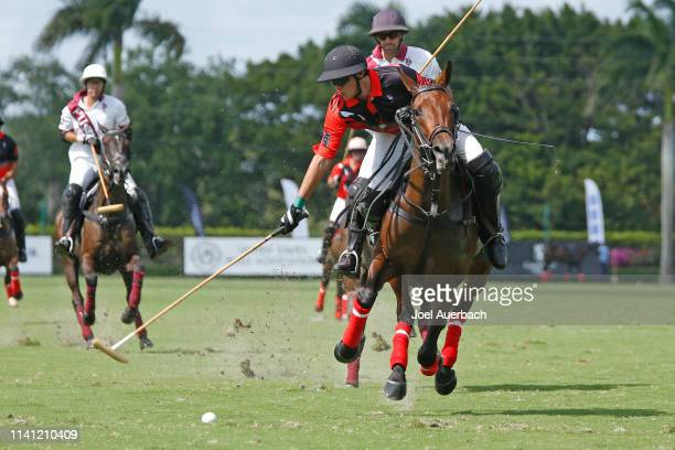 Joaquin Panelo of Postage Stamp plays the ball against Pilot during the 2019 Captive One U.S. Open Polo Championship on April 7, 2019 at the...