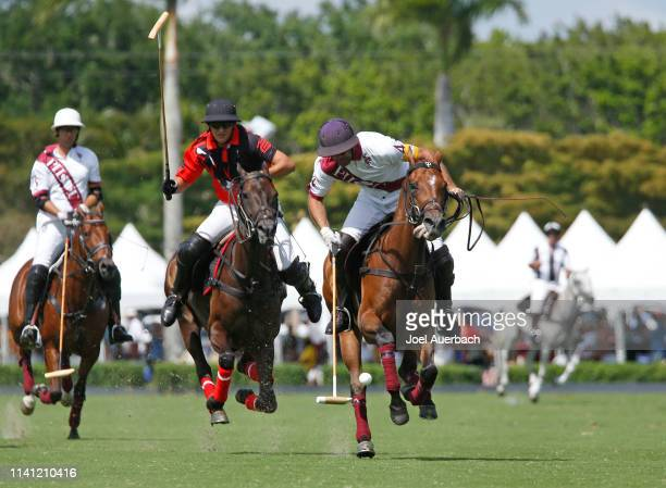 Joaquin Panelo of Postage Stamp pursue Facundo Pieres of Pilot as he brings the ball up field during the 2019 Captive One U.S. Open Polo Championship...