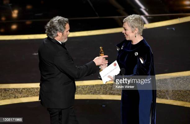 Joaquin Phoenix accepts the Actor In A Leading Role award for 'Joker' from Olivia Colman onstage during the 92nd Annual Academy Awards at Dolby...