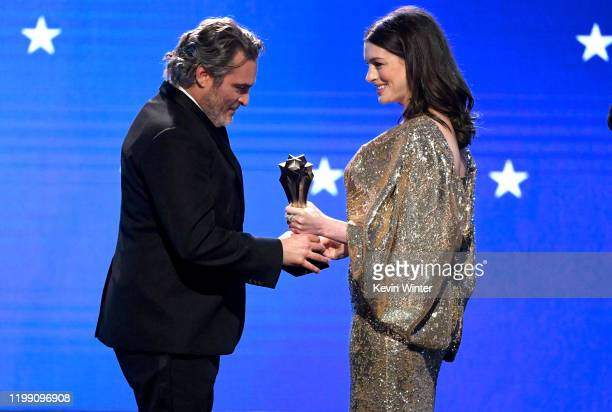 Joaquin Phoenix accepts the Best Actor award for 'Joker' from Anne Hathaway onstage during the 25th Annual Critics' Choice Awards at Barker Hangar on...