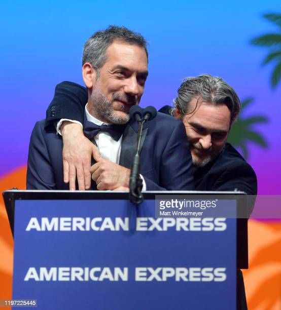 Joaquin Phoenix accepts the Chairman's Award onstage from Todd Phillips during the 31st Annual Palm Springs International Film Festival Film Awards...