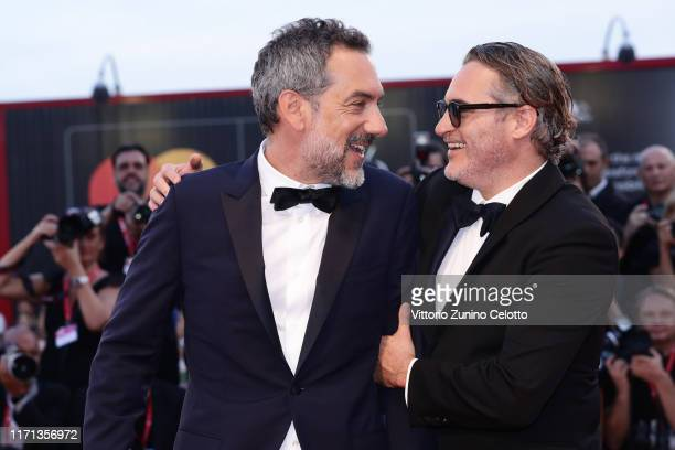 Joaquin Phoenix and Director Todd Phillips walk the red carpet ahead of the Joker screening during the 76th Venice Film Festival at Sala Grande on...