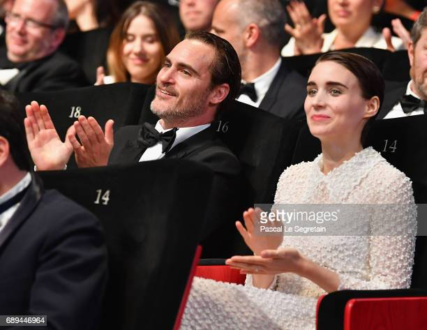 Joaquin Phoenix and Rooney Mara applaud during the Closing Ceremony of the 70th annual Cannes Film Festival at Palais des Festivals on May 28 2017 in...