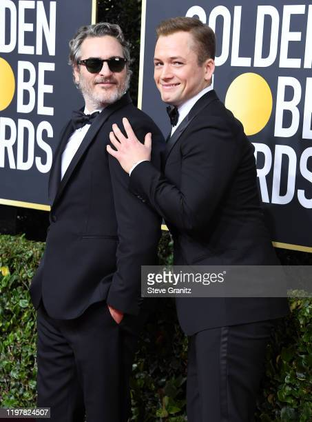 Joaquin Phoenix and Taron Egerton arrives at the 77th Annual Golden Globe Awards attends the 77th Annual Golden Globe Awards at The Beverly Hilton...